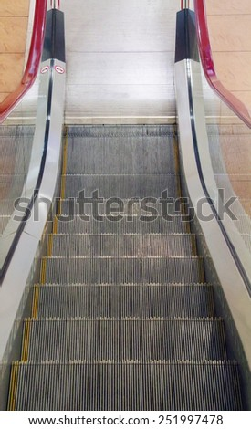 Metal stairs of new moving escalator in modern shopping center - stock photo