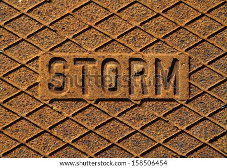 Metal storm manhole cover lid close up - stock photo