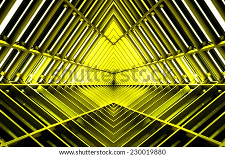 metal structure similar to spaceship interior in yellow light - stock photo