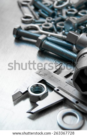 Metal style. Ð¡alliper and other metal tools on the scratched metal background. - stock photo