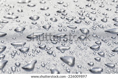 Metal surface covered in water drops bottom, closeup.