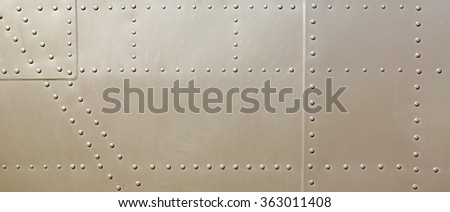metal surface of military aircraft - stock photo