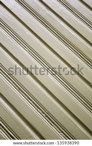 Metal surface with vertical lines in front of building, construction and architecture