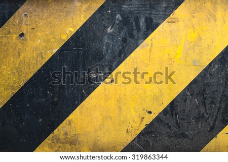 Metal texture with caution sign, scratched surface - stock photo