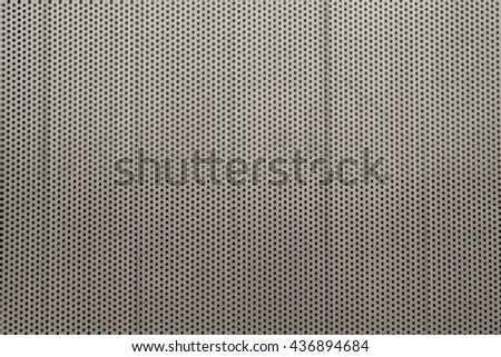 metal texture with holes - stock photo