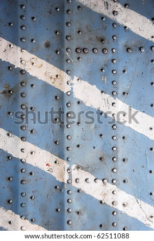 Metal texture with rivets, aircraft fuselage - stock photo