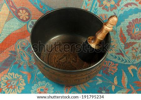 metal Tibetan singing bowl - stock photo
