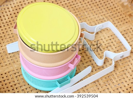 Metal tiffin on wooden background.