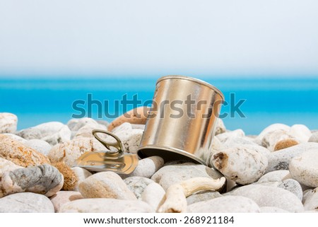 metal tin on the beach - stock photo