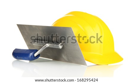Metal tool for building and helmet isolated on white - stock photo