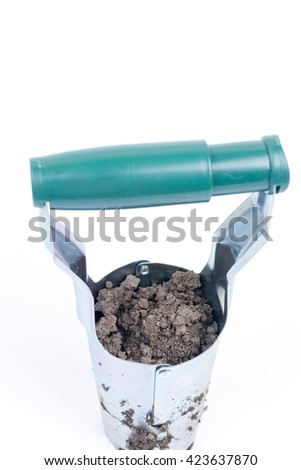 Metal tool for digging holes and planting of fruit and vegetables. - stock photo