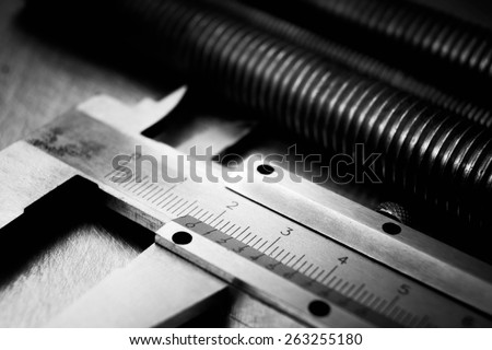 Metal tools. Close up caliper and metal hairpins on the scratched metal background. - stock photo
