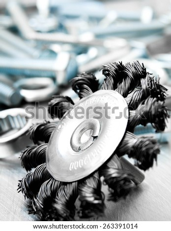 Metal tools. Metal style. Grinding circle and other tools on the scratched metal background. - stock photo
