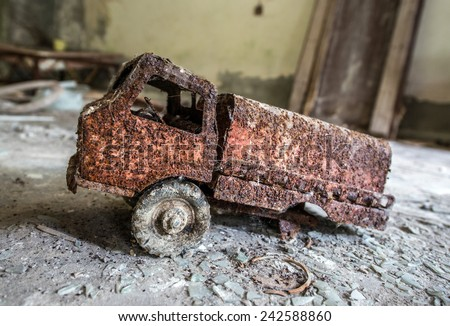 metal toy in preventive clinic called Solnechny in Pripyat town, Chernobyl Nuclear Power Plant Zone of Alienation, Ukraine - stock photo