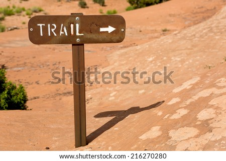 metal trail sign on a rock surface in Arches National Park,  Utah  - stock photo