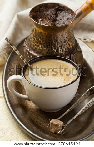 Metal tray with fresh coffee for breakfast  (close-up) - stock photo