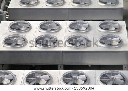 Metal Vents on the top of a building - stock photo