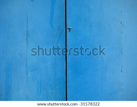 Metal wall, painted in blue color