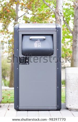 metal wastepaper in park - stock photo