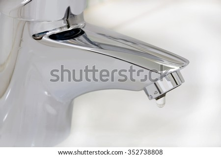metal water tap  - stock photo
