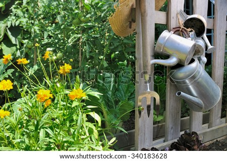 Hanging Watering Can Stock Photos Royalty Free Images Vectors Hanging  Vegetable Garden Metal Watering Cans Hanging From A Fence In A Vegetable  Garden