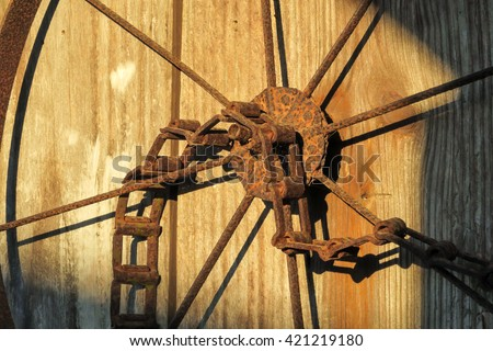 metal wheel and drive chain - stock photo
