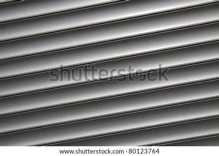 Metal window blinds as stripe pattern
