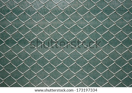 Metal wire fence protection isolated on green for background - stock photo