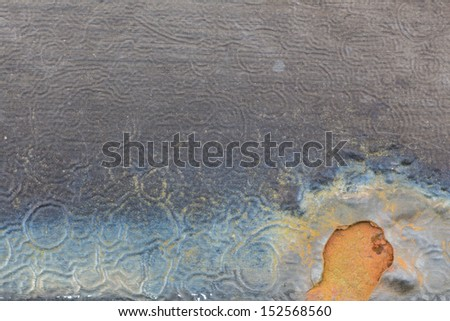 metal with blue and orange rust - stock photo