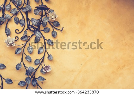 Metal work design on vintage wall in Tuscan house style - stock photo