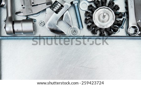 Metal working tools. Metal style. Metal frame and many working tools on the scratched metal background. - stock photo
