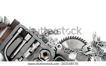 Metal working tools. Metalwork. Box, saw, spanner and others tools on white background.