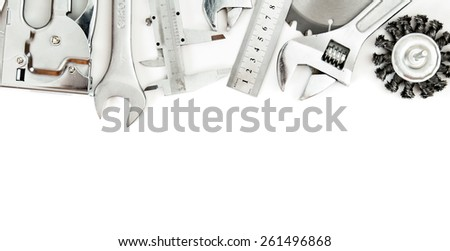 Metal working tools. Metalwork. Wrench, caliper, measure and others tools on white background. - stock photo