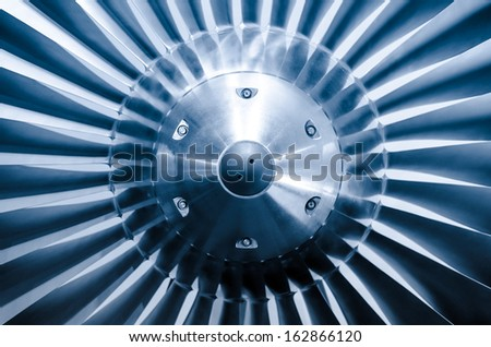 Metalic blue airplane engine vortex / turbofan - stock photo