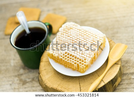 metall cup of tea with cockies on wooden background - stock photo