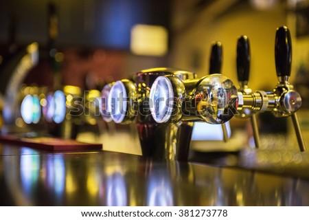 Metallic beer taps - stock photo
