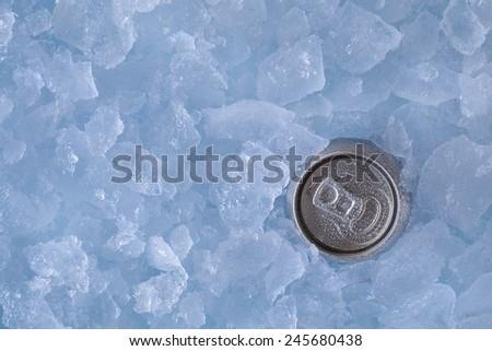 metallic can in ice - stock photo