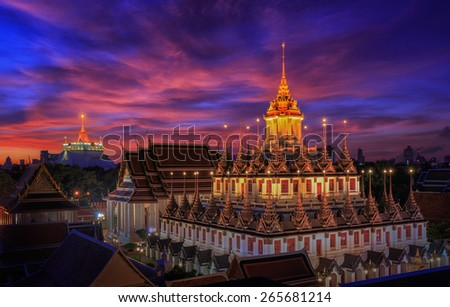 Metallic castle in Wat Phra Kaew area with morning sunrise in Bangkok, Thailand - stock photo