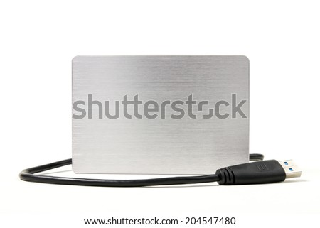 Metallic external hard drive, portable hard disk with USB cable link isolated on white background. - stock photo
