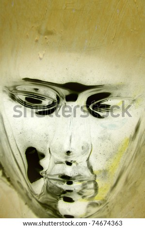 Metallic face with grunge background