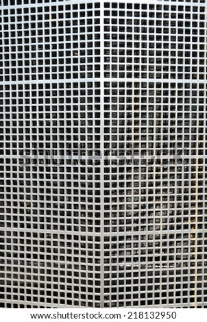 Metallic grille of a historic car in detail - stock photo