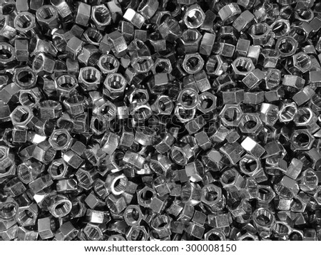 Metallic hexagon head bolt pattern in back and white for industrial background - stock photo