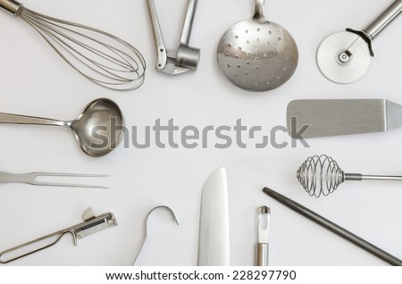 metallic kitchen utensils and tools building a frame - stock photo