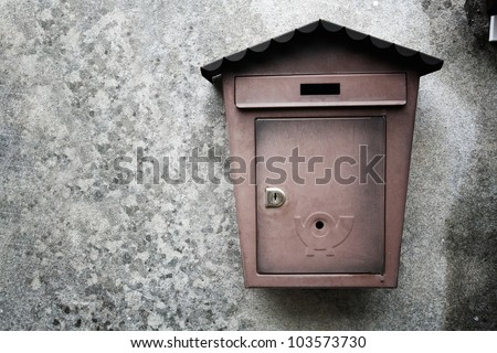 metallic mailboxes on old wall background - stock photo