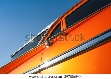 metallic orange vehicle panel abstract