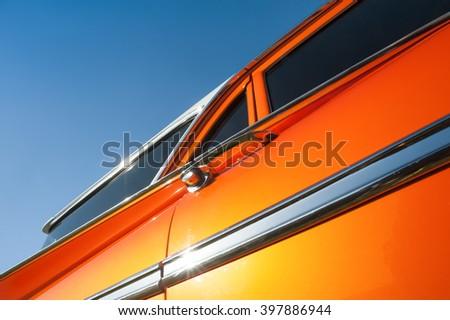 metallic orange vehicle panel abstract - stock photo