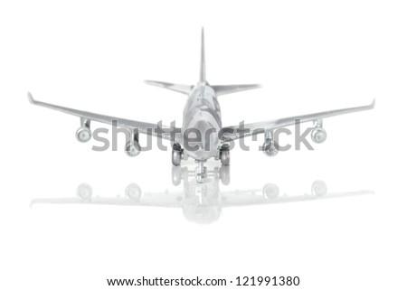 Metallic plane on white background - stock photo