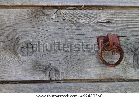 Metallic ring on wooden door
