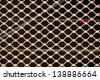 metallic security net with black background - stock photo