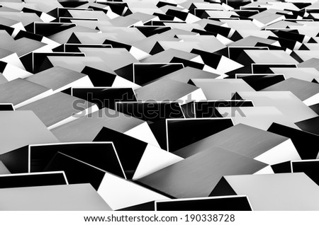 Metallic surface of building facade. Abstract architectural shapes in black and white. Detail image of the Sheffield Cheese Grater car park facade texture.